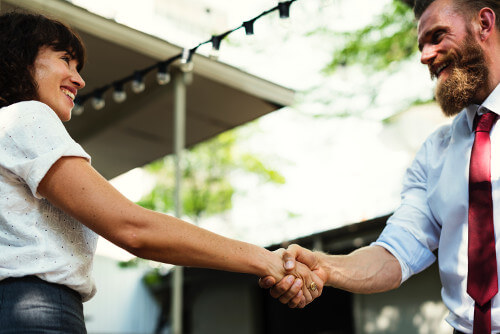 How a CRM system will help your business - man and woman shaking hands